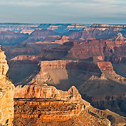 Yavapai Point, South Rim of Grand Canyon National Park, Arizona, USA. Grand Canyon began forming at least 5 to 17 million years ago and now exposes a geologic wonder, a column of well-defined rock layers dating back nearly two billion years at the base. While the Colorado Plateau was uplifted by tectonic forces, the Colorado River and tributaries carved Grand Canyon over a mile deep (6000 feet / 1800 meters), 277 miles (446 km) long and up to 18 miles (29 km) wide.