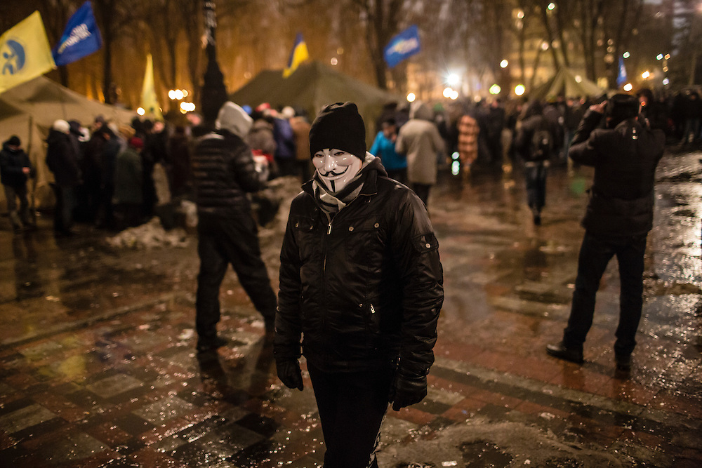 KIEV, UKRAINE - DECEMBER 12: A man in a Guy Fawkes mask attends a rally held by the pro-government Party of Regions in support of Ukrainian President Viktor Yanukovych on December 12, 2013 in Kiev, Ukraine. Thousands of people have been protesting against the government since a decision by President Yanukovych to suspend a trade and partnership agreement with the European Union in favor of incentives from Russia. (Photo by Brendan Hoffman/Getty Images) *** Local Caption ***