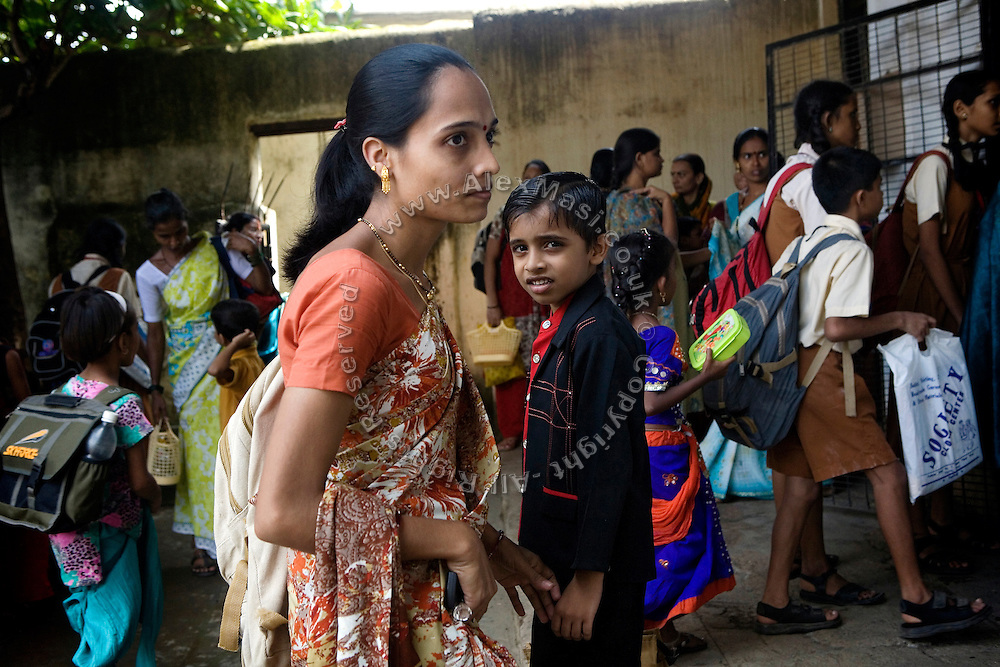 A mother has come to pick up her child from a school run by Sonrisas de Bombay, a fast-growing Spanish NGO in Mumbai, India.