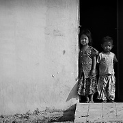 Impoverished Cambodia children look on from their home on the outskirts of Pailin.