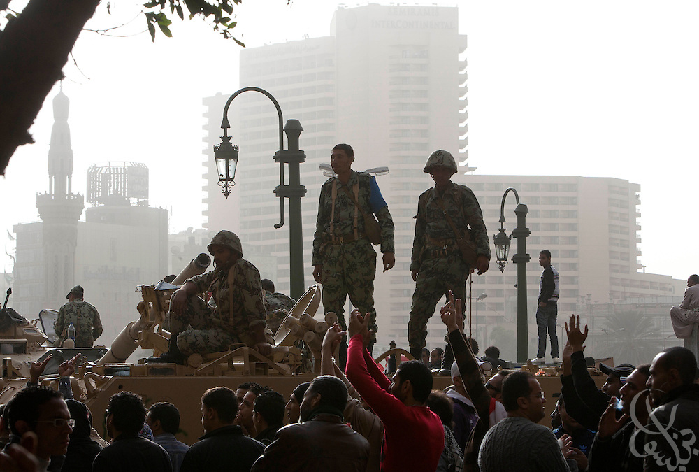 Egyptian soldiers on a tank hold their positions as Egyptian protesters gather again by the thousands in central Tahrir square in downtown Cairo January 29, 2011. The widespread protests across Egypt are an unprecedented challenge to the rule of President Hosni Mubarak.