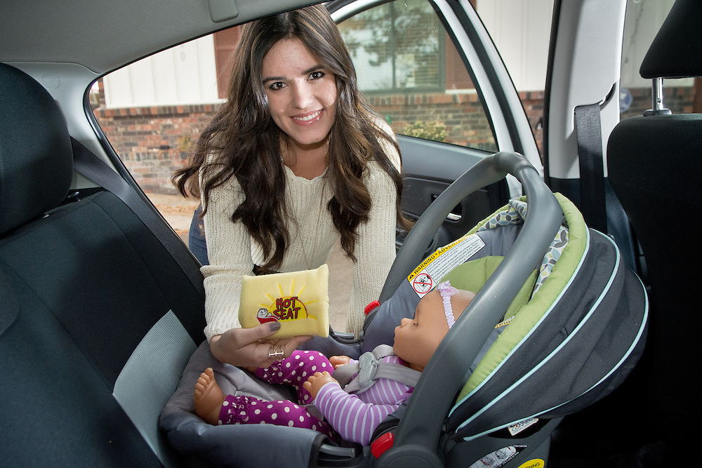 mkb122116b/metro/Marla Brose122116<br /> Entrepreneur and inventor Alissa Chavez, 19, holds a Hot Seat safety sensor, which she created, that works with a smart phone app to make sure that young children are never accidentally left in a hot car. The product is available online, www.babyhotseat.com for $79.99. Chavez came up with the concept, which she now has patented, for a science fair project when she was 14. (Marla Brose/Albuquerque Journal)