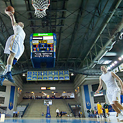 "Delaware 6'2"" Guard Kyle Anderson (13) dunks during warm-ups prior to a regular season NCAA basketball game against George Mason Saturday, March 2, 2013 at the Bob Carpenter Center in Newark Delaware."
