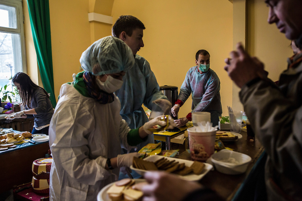 KIEV, UKRAINE - DECEMBER 7: Volunteers serve food to anti-government protesters in the occupied International Centre of Culture and Arts on December 7, 2013 in Kiev, Ukraine. Thousands of people have been protesting against the government since a decision by Ukrainian president Viktor Yanukovych to suspend a trade and partnership agreement with the European Union in favor of incentives from Russia. (Photo by Brendan Hoffman/Getty Images) *** Local Caption ***