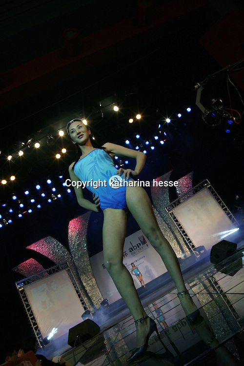 """BEIJING, 18 DECEMBER 2004: Liu Xiaojing, a participent and transvestie  performs at  the """"first worldwide artificial beauty pageant """"  in a theatre in Beijing, 18 December , 2003, in China...Beauty business in China , from cosmetic surgeries to hair brush sales, has amounted to more than USD 7 billion in 2003. The contest for women who have undetgone plastic surgery was organized after Yang Yuan, a young would-be model, was disqualified earlier on this year when organizers discovered that she'd had plastic surgery. Yang was present during the contest to introduce her biography that explains why she has the right to """"improve"""" her natural features... .."""