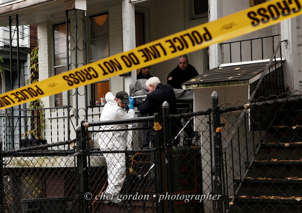 Newburgh Police Crime Scene Detectives and funeral home personnel remove the first of two bodies from 12 Liberty Street in the Heights neighborhood of the City of Newburgh, NY on Friday, November 5, 2010. Two men were the victims of a double homicide last night.