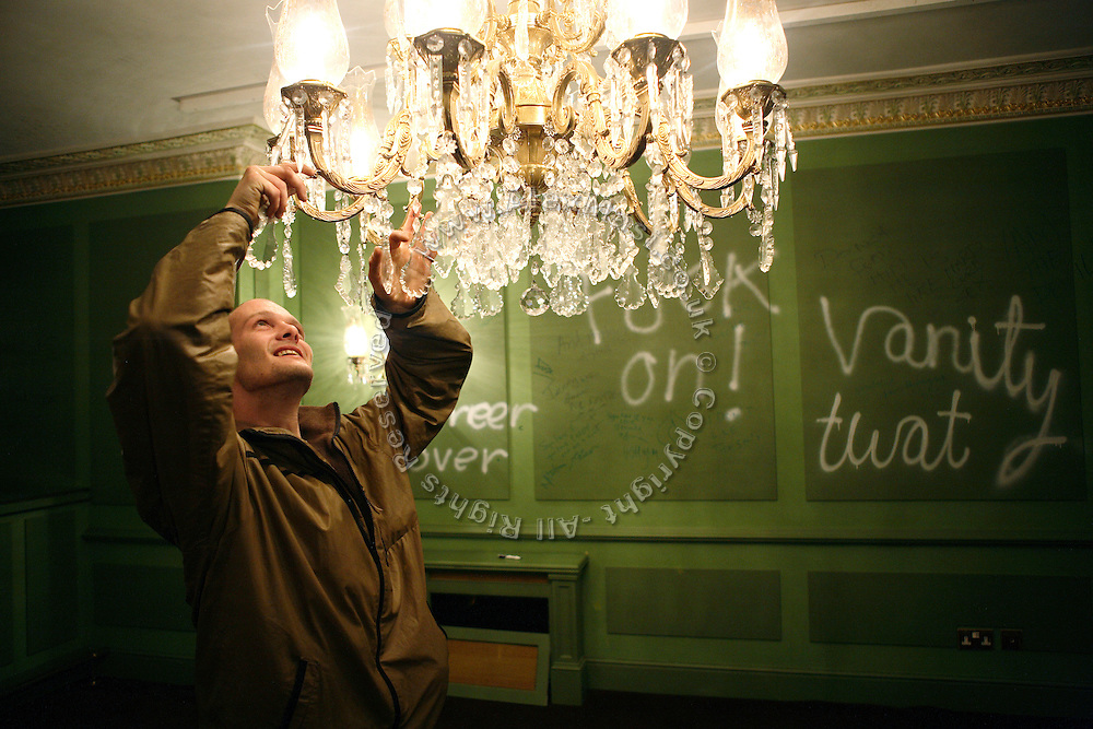 Pete, 26, form Lincolnshire, is smiling in amazement after having discovered electricity is working in the new mansion he and the others have just been able to enter tonight, on Thursday, Oct. 18, 2007, in Hampstead, London, England. The residence, 89 Winnington Road, was former Indonesian President Haji Mohamed Suharto's top London mansion and was sold in 1999 for UK£ 9.5M when he was being investigated in his home country in regards to his fortune and extravagant lifestyle. Million Dollar Squatters is a documentary project in the lives of a peculiar group of squatters residing in three multi-million mansions in one of the classiest residential neighbourhoods of London, Hampstead Garden. The squatters' enthusiasm, their constant efforts to look after what has become their home, their ingenuity and adventurous spirit have all inspired me throughout the days and nights spent at their side. Between the fantasy world of exclusive Britain and the reality of squatting in London, I have been a witness to their unique story. While more than 100.000 properties in London still lay empty to this day, squatting provides a valid, and lawful alternative to paying Europe's most expensive rent prices, as well as offering the challenge of an adventurous lifestyle in the capital.