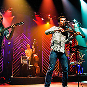 "Old Crow Medicine Show performing at ACL Live at the Moody Theater, Austin, Texas, November 28, 2012.  Old Crow Medicine Show is an Americana string band based in Nashville, Tennessee. Their music has been called old-time, bluegrass, folk, and alt-country. Along with original songs, the band performs many pre-World War II blues and folk songs. Recording since 1998, they have released four studio albums—O.C.M.S. (2004), Big Iron World (2006), Tennessee Pusher (2008), and Carry Me Back (2012). Their song ""Wagon Wheel"", co-authored with Bob Dylan, was certified gold by the Recording Industry Association of America in November 2011."