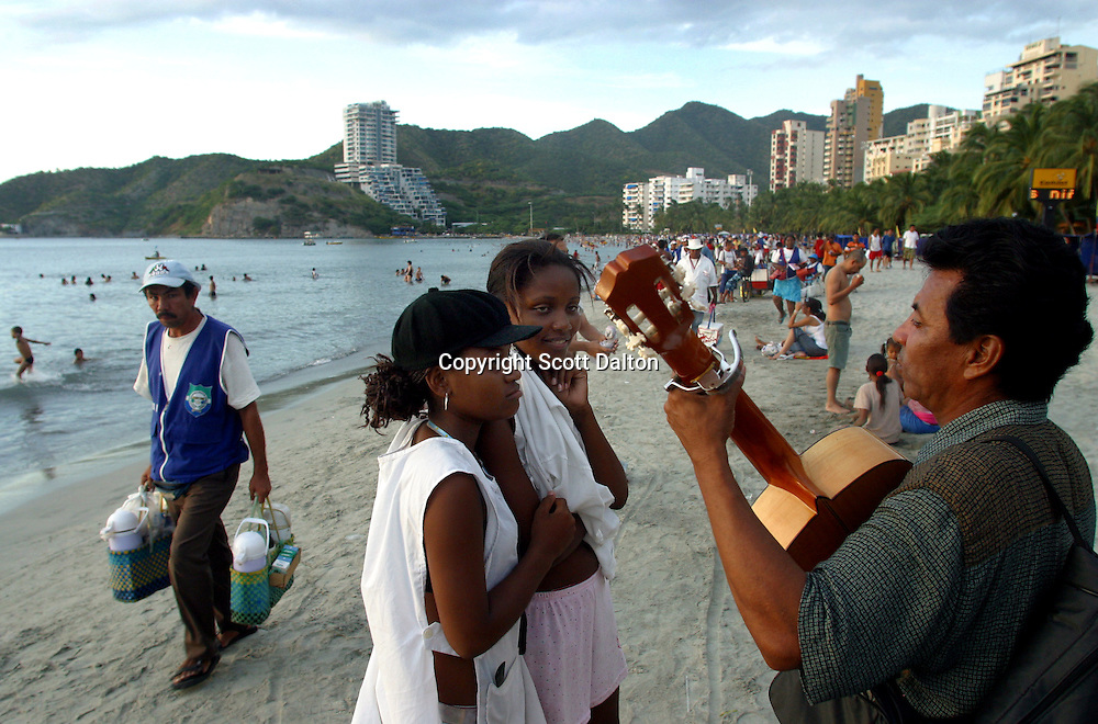 A musician plays on the beach in El Rodadero, just outside of Santa Marta on Colombia's Caribbean coast, on Monday, December 12, 2005. The government has increased security along the countries highways and now more and more Colombians are starting to travel to popular destinations throughout the country. (Photo/Scott Dalton)