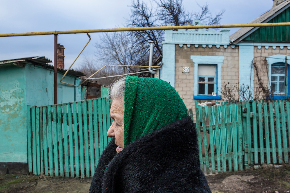 DONETSK, UKRAINE - FEBRUARY 3, 2015: A woman outside her home in the Petrovsky district of Donetsk, Ukraine. The neighborhood has been under heavy shelling for the past four days, and a brief pause allowed a few residents to leave their basement hiding places for some fresh air. CREDIT: Brendan Hoffman for The New York Times