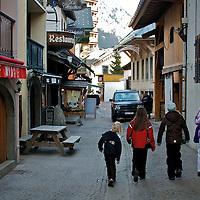 Kids walking in an alley