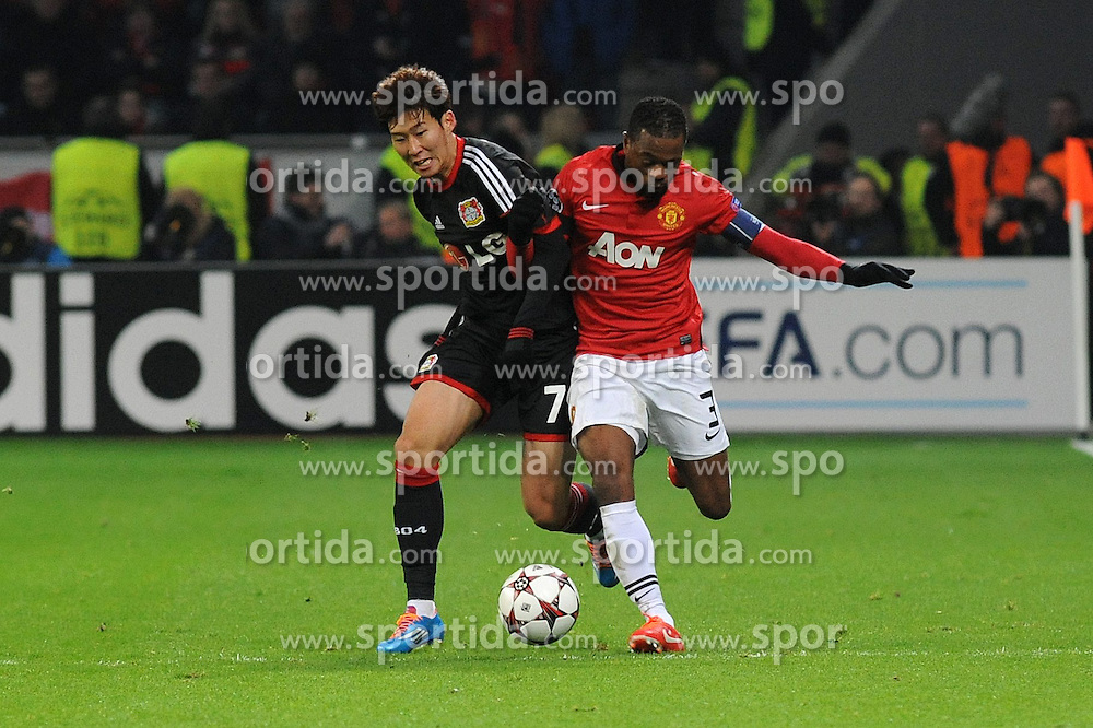 27.11.2013, BayArena, Leverkusen, GER, UEFA CL, Bayer Leverkusen vs Manchester United, Gruppe A, im Bild Heung Min Son ( links Bayer 04 Leverkusen ) im Zweikampf mit Patrice Evra ( rechts Manchester United / Action / Aktion ) // during UEFA Champions League group A match between Bayer Leverkusen vs Manchester United at the BayArena in Leverkusen, Germany on 2013/11/28. EXPA Pictures &copy; 2013, PhotoCredit: EXPA/ Eibner-Pressefoto/ Thienel<br /> <br /> *****ATTENTION - OUT of GER*****