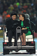NELSON MANDELA and his wife GRACA MACHEL wave to the cheering crowd from a golf cart during the closing ceremony of the 2010 FIFA World Cup in Johannesburg, South Africa on Sunday 11 July 2010. This would be his last public appearance.<br /> Photo by Roger Sedres