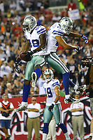 Dec 17, 2011;  Tampa, FL, USA; Dallas Cowboys wide receiver Miles Austin (19) watches as wide receiver Dez Bryant (88) and wide receiver Laurent Robinson (81) celebrate after scoring a touchdown during the first quarter against the Tampa Bay Buccaneers at Raymond James Stadium.