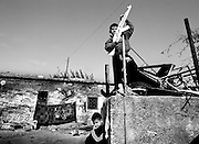 Small boys waiting for a funeral procession; they have acquired yet another martyr. <br /> Nov. 2002 The separation wall goes thru the israeli/palestinian countries as a snake and a constant reminder of the state of the country.