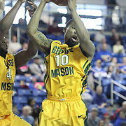 George Mason Guard Sherrod Wright (10) grabs a rebound in the first half of a regular season NCAA basketball game against Delaware Saturday, March 2, 2013 at the Bob Carpenter Center in Newark Delaware.