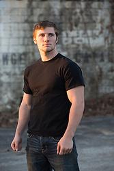 man standing near a graffiti wall