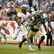 SHOT 9/19/15 6:22:51 PM - Colorado State's Rashard Higgins #82 looks up for the ball on a deep pass against Colorado's Ahkello Witherspoon #23 during the Rocky Mountain Showdown at Sports Authority Field at Mile High in Denver, Co. Colorado won the game 27-24 in overtime. (Photo by Marc Piscotty / © 2015)
