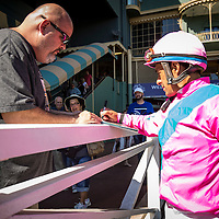 ARCADIA, CA - OCTOBER 01: Jockey, Victor Espinoza signs an autograph for a fan at Santa Anita Park on October 01, 2016 in Arcadia, California. (Photo by Alex Evers/Eclipse Sportswire/Getty Images)