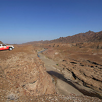 Wadi Khamees, an old river bed on the Hajar Mountains in Oman.<br />
