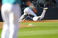 Ole Miss' Auston Bousfield (9) is tagged out at third by North Carolina-Wilmington's Dillon Bass (9) at Oxford-University Stadium in Oxford, Miss. on Friday, February 24, 2012. Ole Miss won 2-0.