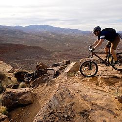 A rider negotiates a gnarley section of the Barrel Rolls trail near Saint George, Utah.