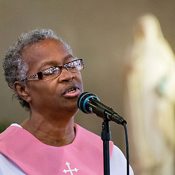 2 AUG. 2015 -- ST. LOUIS -- A member of the choir at Sts. Teresa and Bridget Catholic Parish performs during Mass Mob III held at the church in St. Louis Sunday, Aug. 2, 2015. The event brings Catholics from across the Archdiocese of St. Louis to worship at historic, urban parishes.<br /> <br /> Photo by Sid Hastings.