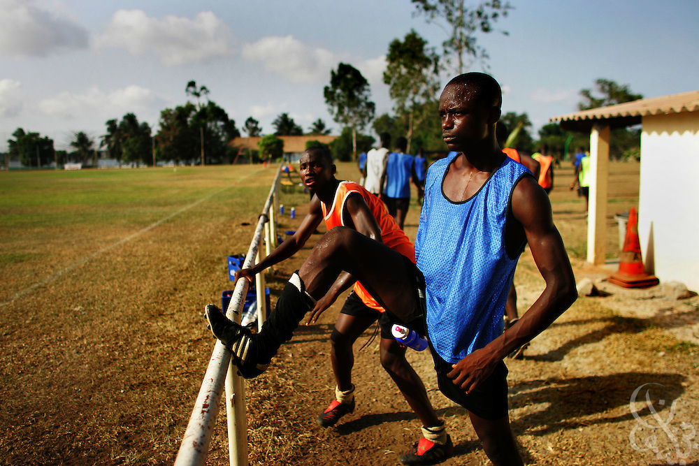Teenage Ivorian football players warm up before taking to the pitch for a morning training session on the grounds of the ASEC football academy February 16, 2006 in Abidjan, Ivory Coast. ASEC academy has an established history of producing top notch footballers who go on to play in the top European football leagues.