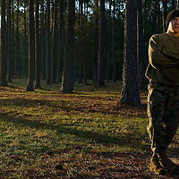 Lance Cpl. Christopher Sitchler leans against a tree at Parris Island, S.C., on Nov. 24, 2007. (Photo by Stacy L. Pearsall)