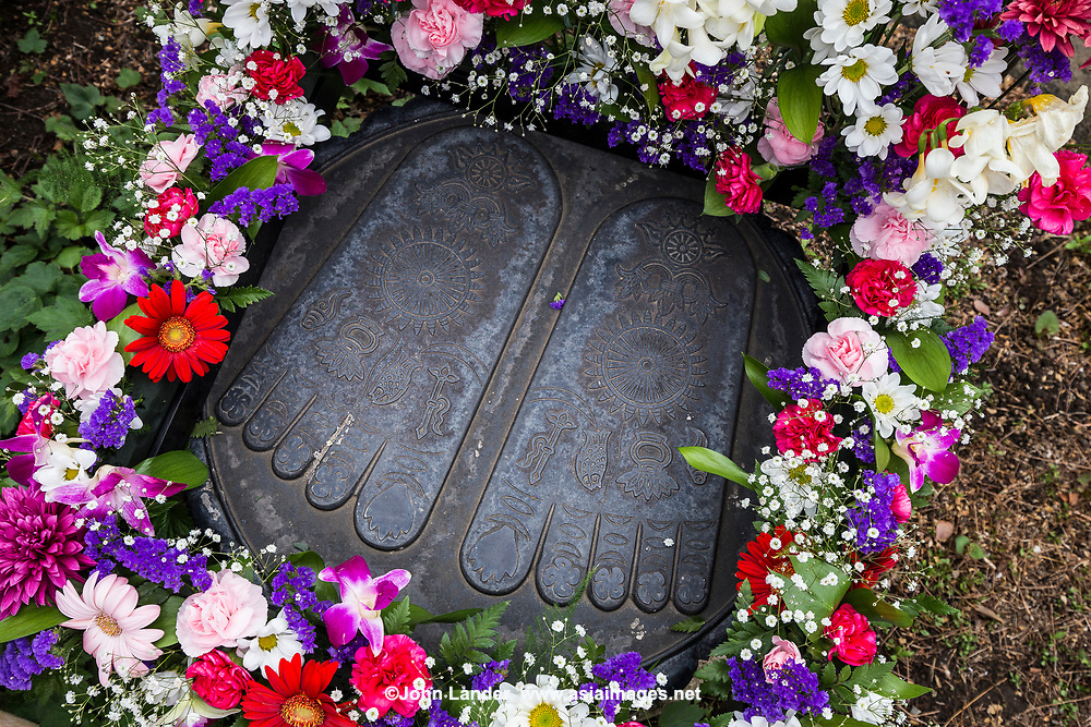 The footprints of the Buddha are venerated in all Buddhist countries. They generally show all the toes to be of equal length, and often bear distinguishing marks - either a Dharma wheel or chakra at the centre of the sole, or the 32, 108 or 132 distinctive signs of the Buddha, engraved or painted on the sole and inscribed in a pattern. These footprints are at Hase-Dera Temple in Kamakura.