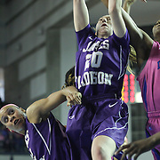 James Madison Guard Kirby Burkholder (20) pulls down the rebound in the first half of a regular season NCAA basketball game against Delaware Sunday, Feb 24, 2013 at the Bob Carpenter Center in Newark Delaware.