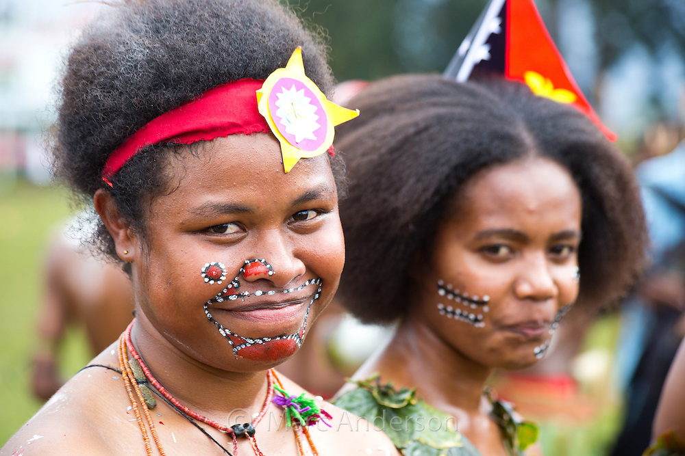 Portrait of young women from Milne bay province dressed in traditional tribal dress for the Goroka Show, an annual Singsing Festival in the highlands of Papua New Guinea