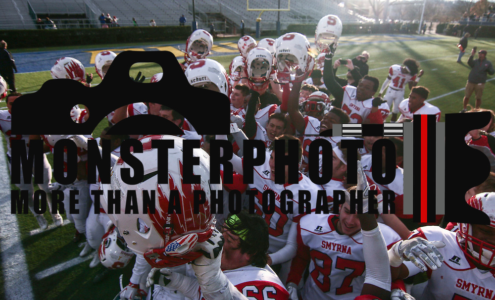 Smyrna (12-0) players celebrate after winning their second straight DIAA division one Football Championship defeating Top-seeded Middletown (11-1) 36-14 Saturday, Dec. 03, 2016 at Delaware Stadium in Newark.