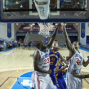 Delaware 87ers Forward Victor Rudd (23) and Delaware 87ers Forward Drew Gordon (32) battle for the rebound under the basket as Santa Cruz Warriors Center Ognjen Kuzmic (32) defends in the second half of a NBA D-league regular season basketball game between the Delaware 87ers and the Santa Cruz Warriors (Golden State Warriors) Tuesday, Jan. 13, 2015 at The Bob Carpenter Sports Convocation Center in Newark, DEL