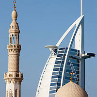 United Arab Emirates, Dubai, Minaret and dome at Umm Suqeim Mosque with nearby Burj al-Arab Hotel