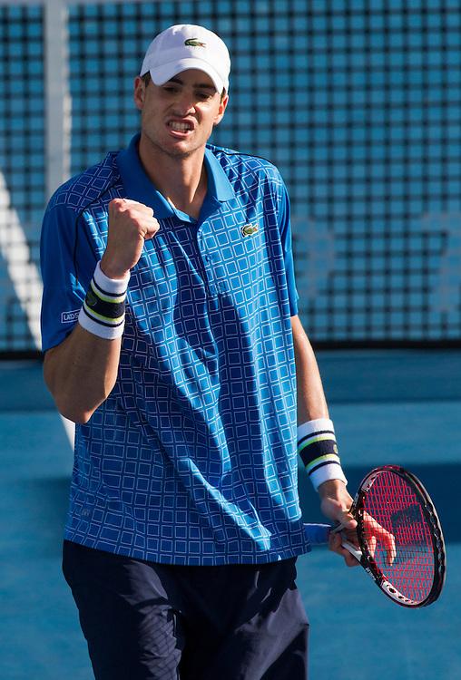 USA's John Isner celebrates winning in his quarterfinal singles match against Germany's Philipp Kohlschreiber at the Heineken Open Men's Tennis Tournament, Auckland, New Zealand, Thursday, January 09, 2014.  Credit:SNPA / David Rowland