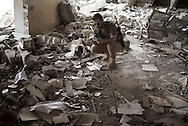 Iraq, Kurdistan: Peshmerga soldiers searches among rubbles in a heavily destroyed building in Sinjar. <br /> For more than one year between 2014 and 2015 Sinjar has been under ISIS control. When in November 2015 Peshmerga forces and Yazidi militias backed by US airstrikes entered the town and fully regained full control from IS, found the city heavily destroyed. Alessio Romenzi