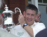 Photo Peter Spurrier.01/09/2002.Village Cricket Final - Lords.Elvaston C.C. vs Shipton-Under-Wychwood C.C..Shipton Captain, Paul Hemming, holds the trophy After winning the final at Lords.