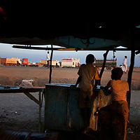 Two boys watch the traffic onthe main road in Abyei. The town is tense after Police said they repelled an attack by Missereyi 14 kilometers north of Abyei.