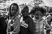 WASHINGTON, USA - APRIL 21: Kids watch as thousands gather to march through the streets of Baltimore to seek justice for the death for Freddie Gray who died from injuries suffered in Police custody in Baltimore, USA on April 21, 2015.