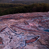 Bald Rock is a formerly beautiful granitic dome in the Upstate of South Carolina, which has been repeatedly spray painted by visitors for several years. Although this Heritage Preserve in the South Carolina Mountains offers an amazing view, pollution, trash and grafitti have reduced its natural appearance.
