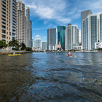 Kayakers pass Brickell Key at the entrance of the Miami River in downtown Miami, Florida.
