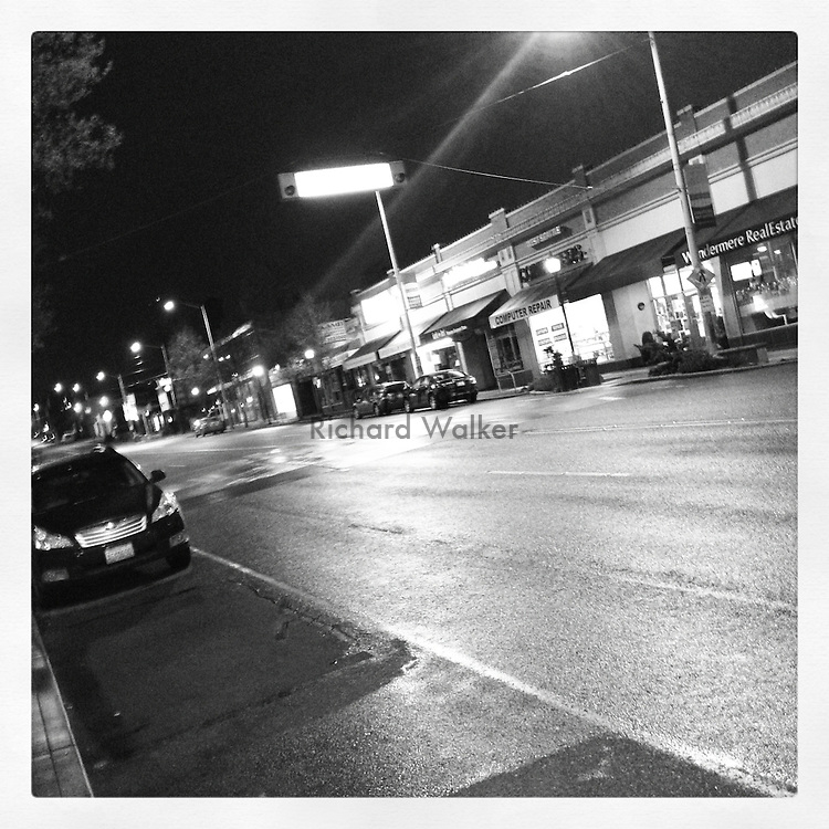 2012 JANUARY 19 - California Ave SW in the Alaska Junction in West Seattle WA on a rainy night. Taken with Apple iPhone using Instagram App. By Richard Walker