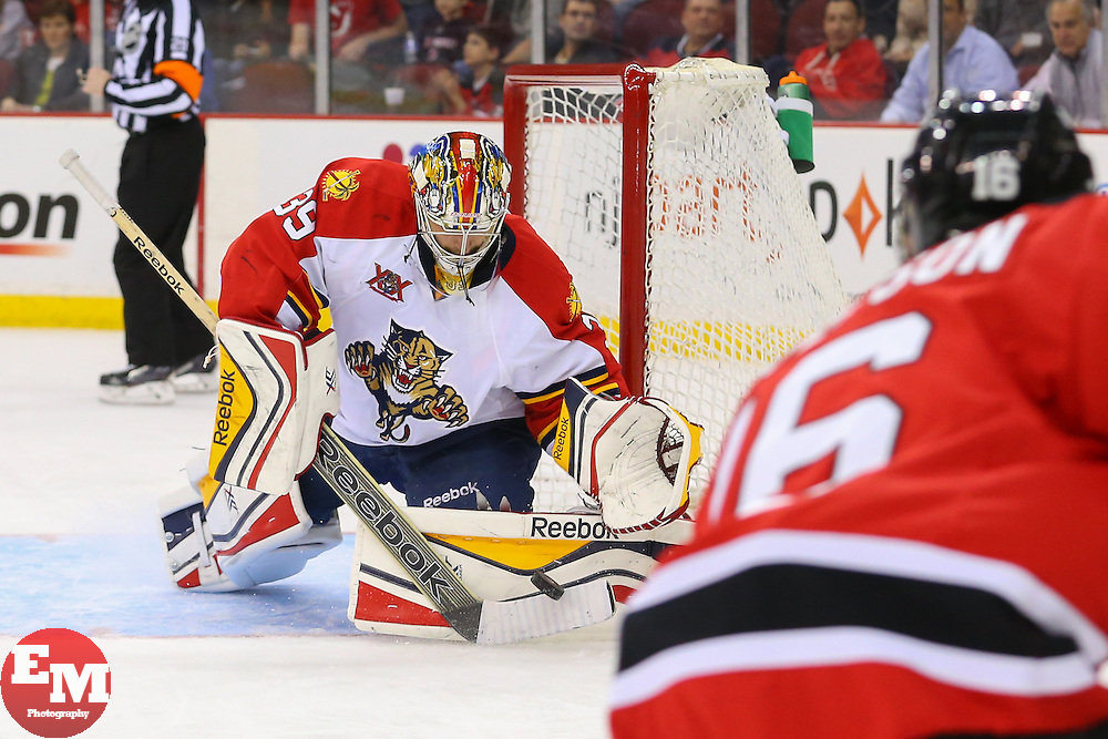 Mar 31, 2014; Newark, NJ, USA; Florida Panthers goalie Dan Ellis (39) makes a save on New Jersey Devils center Jacob Josefson (16) during the first period at Prudential Center.