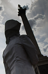 London, July 18th 2015.  A living statue stands in the shadow of Nelson's columnduring the  Busk in London Festival aimed at showcasing the outstanding talents of many of the capital's finest street performers, including, musicians, magicians, living statues and bands.