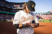 SAN FRANCISCO, CA - APRIL 18:  Brandon Crawford #35 of the San Francisco Giants admires his  2014 World Series ring during the San Francisco Giants World Series ring ceremony at AT&T Park on Saturday, April 18 2015 in San Francisco, California. Photo by Jean Fruth