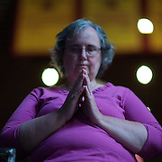 An attendee prays at the beginning of the Iowa Straw Poll Saturday, August 13, 2011, in Ames, Iowa (IA)...Photo by Khue Bui.