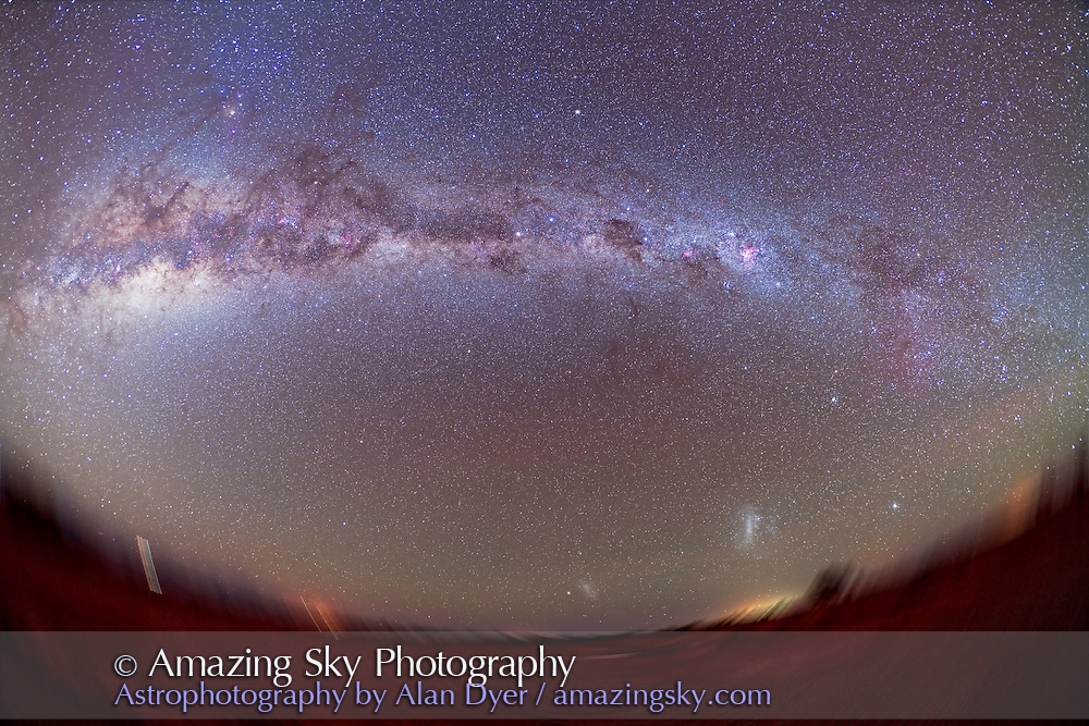 Southern Milky Way from Atacama Lodge, Chile (latitude 23° S) taken March 14/15, 2010. Taken witn Canon 5D MkII (modified) and Canon 15mm lens at f/4 for stack of 4 x 6 minute exposures at ISO 800. Milky Way sweeps from Puppis (right) to Sagittarius (left). Ground is trailed into a rotational blur because camera was tracking the sky. Ground rotates because camera was aimed toward the South Celestial Pole. Images Mean combined.