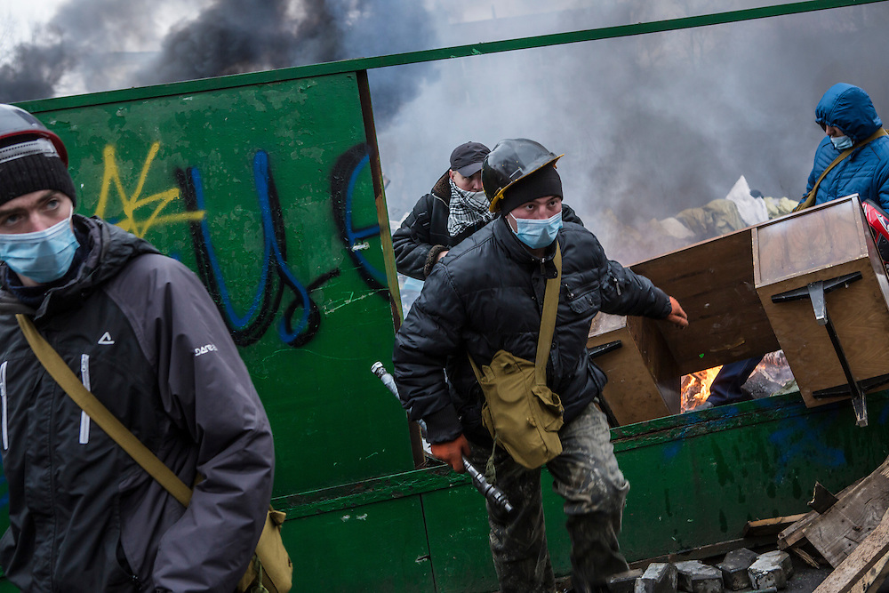 KIEV, UKRAINE - FEBRUARY 20: Anti-government protesters work to reinforce barricades on February 20, 2014 in Kiev, Ukraine. After several weeks of calm, violence has again flared between anti-government protesters and police, with dozens killed. (Photo by Brendan Hoffman/Getty Images) *** Local Caption ***