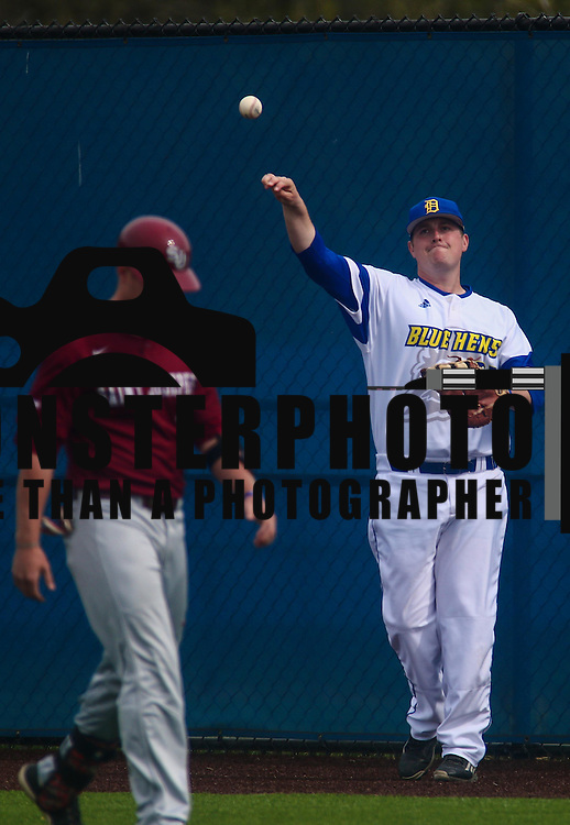 Delaware Infielder Nick Liggett (22) throws the ball back to the pitcher mound during a regular season baseball game between Delaware and Saint Joseph's at Bob Hannah Stadium Tuesday April 19, 2016, in Newark.